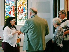 Nicole Khoury chats with visitors concerning the Church's stained-glass.
