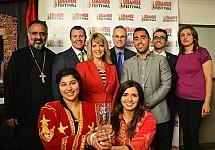 Fr. Maximos Saikali, Giselle Hage, Christine Awad, Milad Saikali, and Affaf El-Jakl thank TD Bank sponsors.