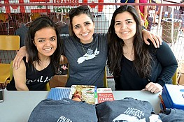 Abir Ayoub, Christine Awad & her sister selling shirts to support the Leukemia & Lymphoma society, at the Lebanese Festival.