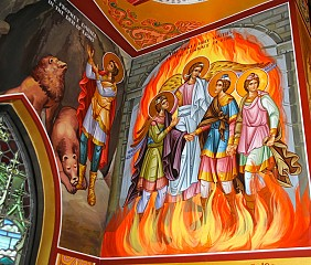 The Prophet Daniel amongst lions in their den, and the youths safeguarded by God.